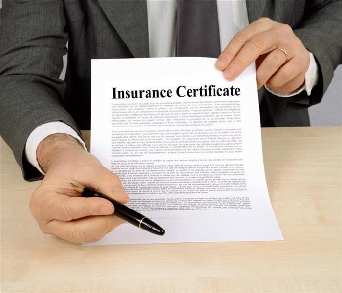 INSURANCE DOCUMENT PRESENTED FROM A SALESMAN IN A SUIT