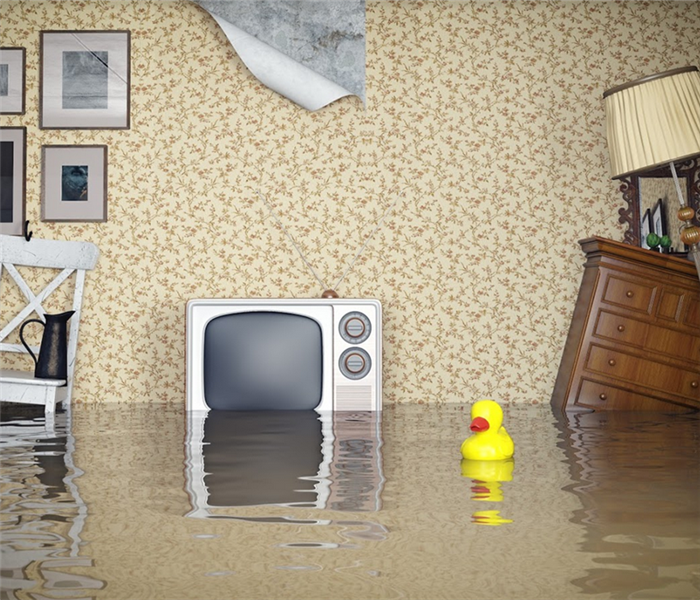 flooded living room with furniture floating